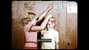 1960s, 1970s USA, Brother and Sister Measuring Heights, 16mm
