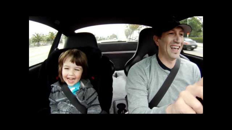 My boy laughing in the Porsche on the way to school..