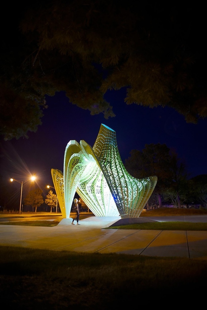 MARC FORNES / THEVERYMANY sculpts bright green hyperbolic paraboloid pavilion