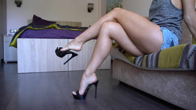 Foot model with french pedicure shows her legs, soles and feet