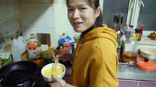 COOKING WITH THE CHAMP Zhang Weili