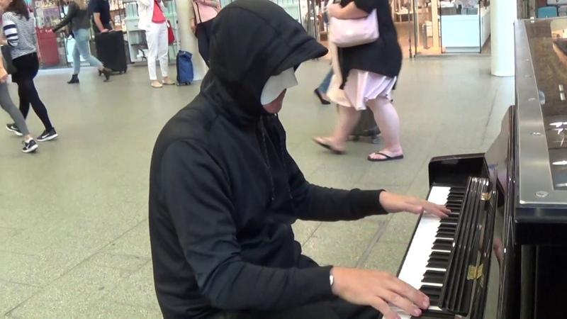 Disguised Boogie Woogie Pianist Improvises Rachminoff